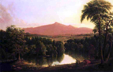 Landscape by a River with Mountains in the Distance